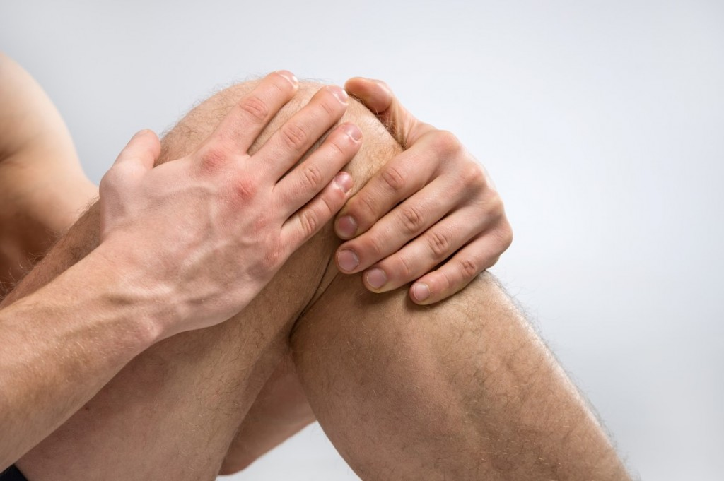 Man suffering from knee pain.